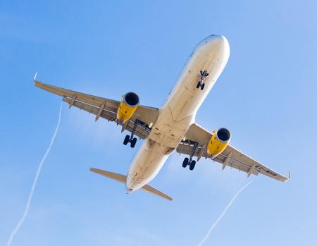 BARCELONA, SPAIN - MARCH 09, 2017:  Vueling Airlines plane landing in El Prat Airport on time. Barcelona, Spain