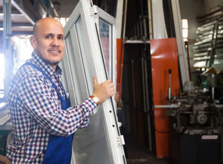 Portrait of smiling worker at PVC windows factory Stock Photo
