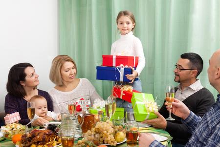 granny and grandad: Celebrating girl birthday in big family at festive table