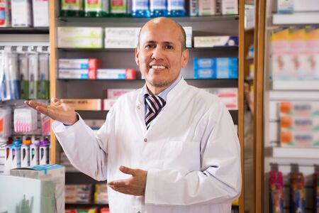 Friendly maven consulting chemists shop Stock Photo