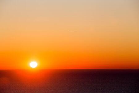 fiery sunrise over ocean