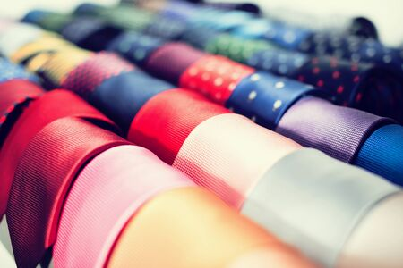 row of Neckties on hangers in men clothing store