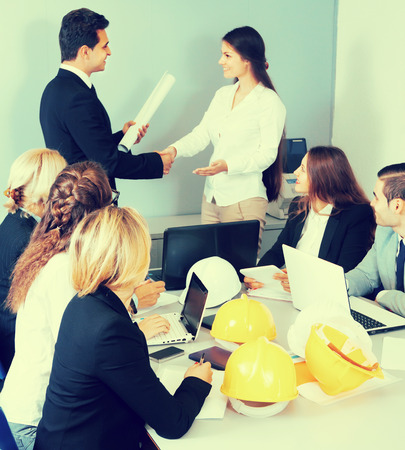 Business handshake at negotiations in office