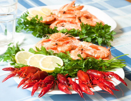 cooked shrimp and crayfish served on plate close up