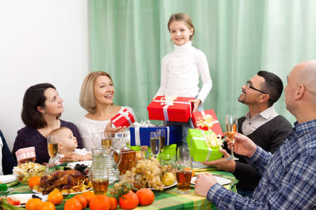 granny and grandad: Big family celebrating young girl birthday at festive table in home Stock Photo