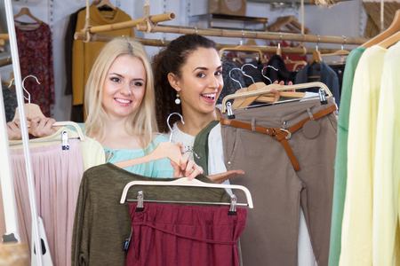 Two pretty girls enjoyed shopping in a boutique Stock Photo