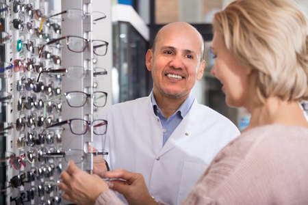 friendly  doctor consulting near eye chart Stock Photo