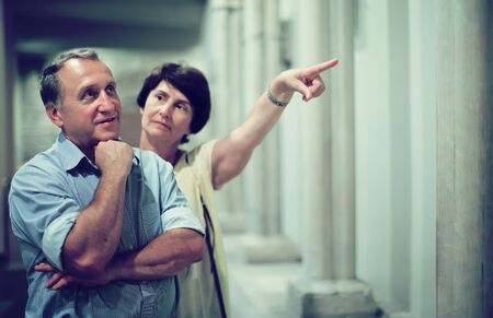 mature pensioner family visiting historical exhibition in National Museum Stock Photo