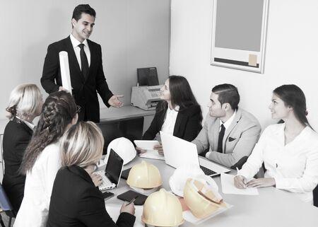 building chief speech at meeting in office Banco de Imagens