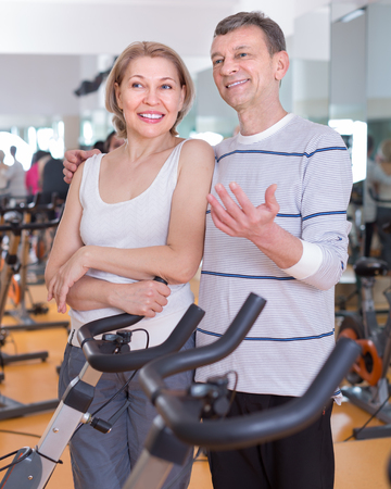 Portrait of a smiling mature couple in sportswear in gym Stock Photo