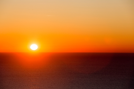 View of morning sun rising over sea Stock Photo