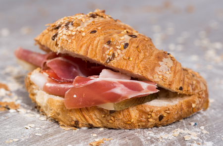 sandwich made with croissant cheese and Parma ham