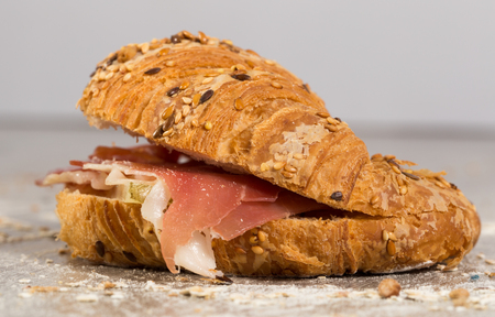 sandwich made with croissant cheese and Parma ham Stock Photo - 95720700