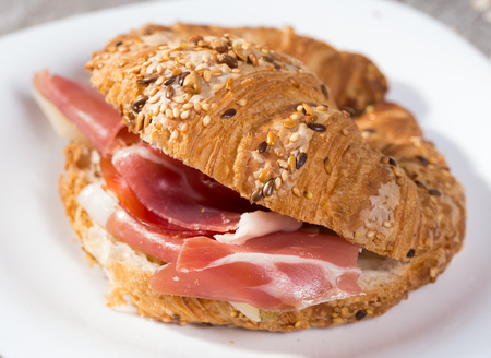 sandwich made with croissant cheese and Parma ham Stock Photo - 95672347