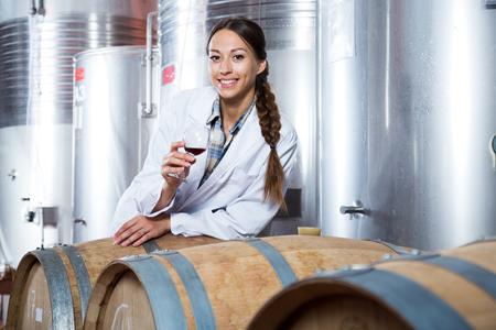 woman sommelier is tasting wine at Italian wine factory