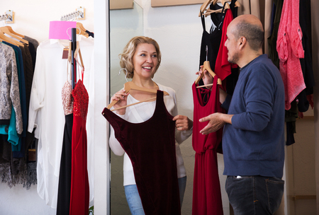 laughing couple looking for a elegant clothes Archivio Fotografico