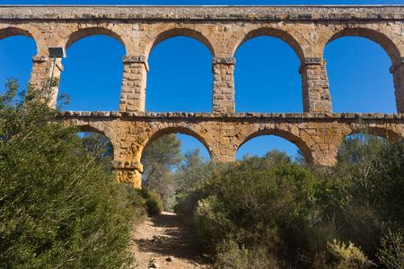 ancient Roman aqueduct in city of Taragona in summer