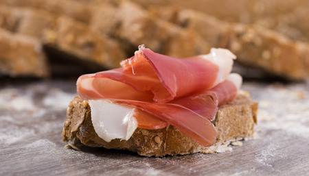 perfect sandwich made with rye bread cheese and Parma ham