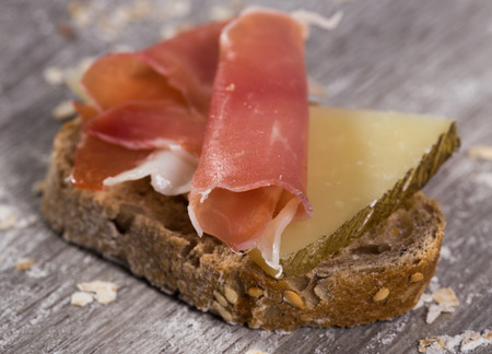 perfect sandwich made with rye bread cheese and Parma ham Stock Photo - 107681024