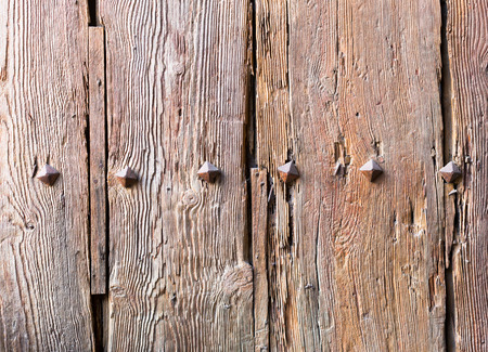 texture of old wooden door with iron forged rivets