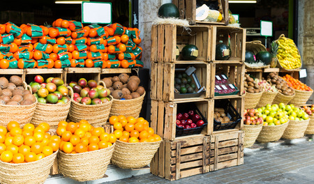 fresh vegetables and fruits in wicker baskets on counter of greengrocery Stok Fotoğraf