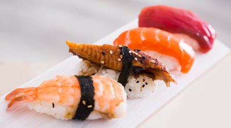 close-up of series of four kinds Nigirisushi. focus on unagi