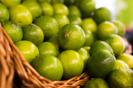 ripe fresh limes in baskets on counter