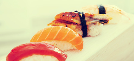 series of four kinds Nigirisushi. focus on sake Foto de archivo