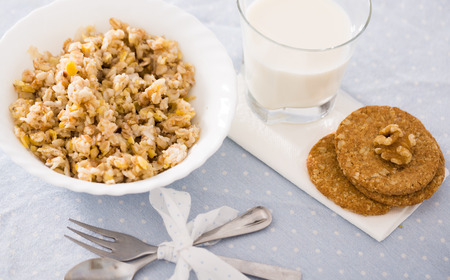 plate with cereal porridge for breakfast and cookies