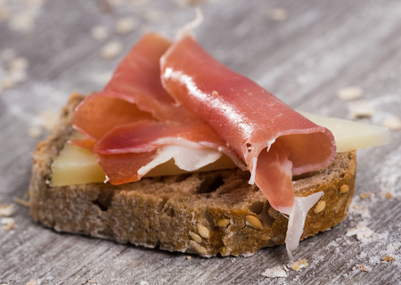 perfect sandwich made with rye bread cheese and Parma ham Stock Photo - 120665371