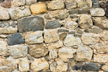 shabby surface of ancient wall of natural stone