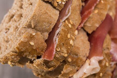 delicious tiered sandwich made with with rye bread and ham