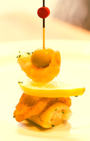 Sophistication pintxos with shrimps lemon and olive