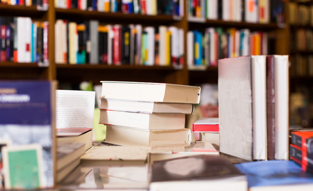 different art books lying on table in library