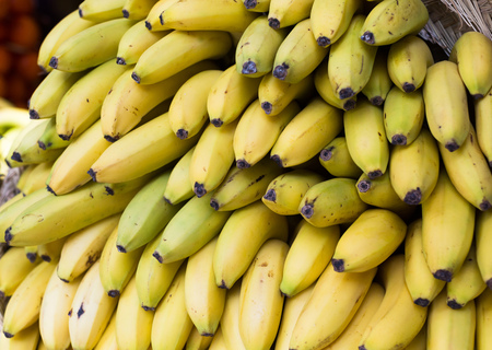 mature appetizing bananas on counter in market Imagens