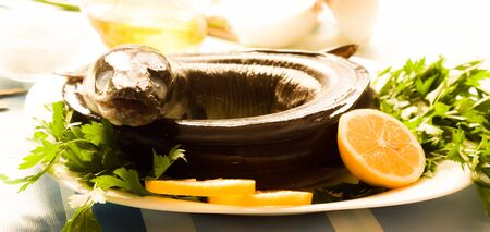 Image of freshness fish eel and vegetables on the plate at the table