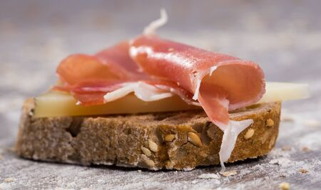 perfect sandwich made with rye bread cheese and Parma ham Stock Photo - 132023782