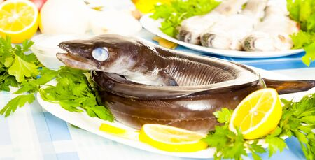 Image of freshness fish eel and vegetables on the plate at the table Stock Photo