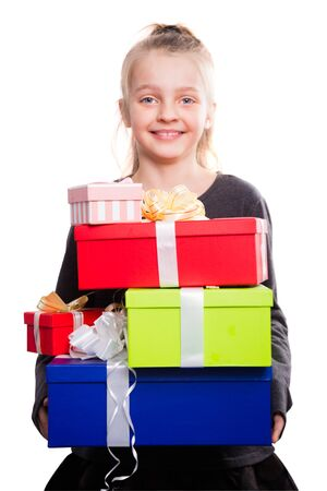 portrait of blonde girl holding in hands lots of boxes with gifts on isolated background