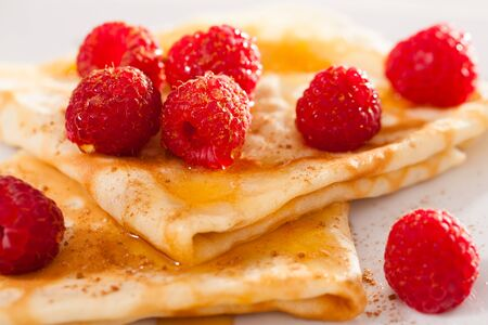 delicious pancakes with raspberries and honey