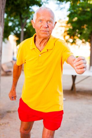 active elderly man on morning run in park