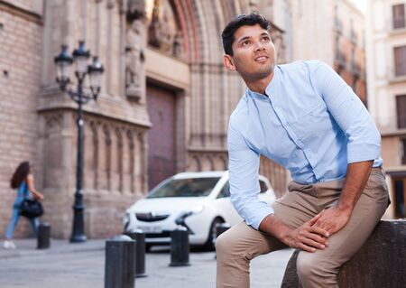 young man posing in gothic quarter of Barcelona