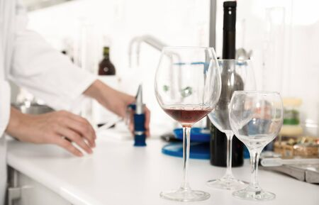 laboratory of winery. Checking the acidity of wine and organoleptic characteristics Imagens - 134482798
