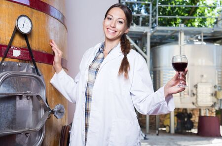 professional woman checks the wine at factory in France Reklamní fotografie