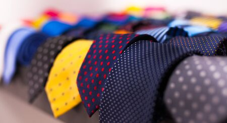 Neckties on hangers in men clothing store