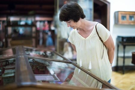 female pensioner visiting historical exhibition in National Museum