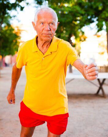 mature European man jogging in park Imagens
