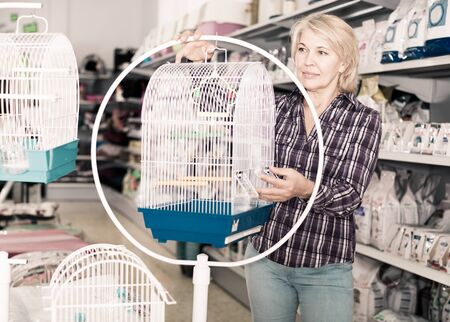 female customer choose rainforest cage in store