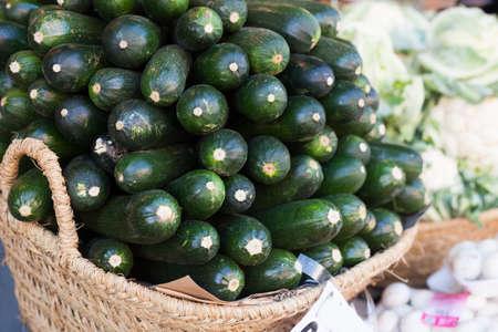 zucchini on market counter in wicker basket