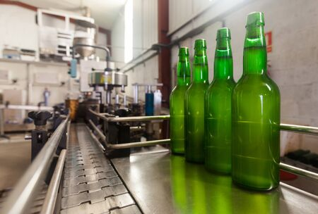 green bottles on a production line in a cider factory